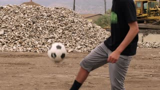 Boy Juggling Soccer Ball