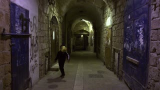 Boy Kicking Soccer Ball In Arched Alley At Night 4