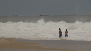 Boys Playing In Waves