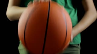 Brave boy bouncing a basketball, efforts