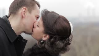 Bride and groom kissing outdoors. Romantic moments.