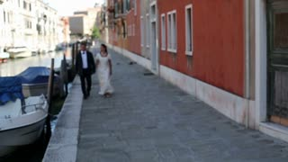 Bride and Groom slow motion hand in hand