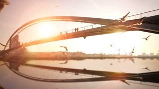 bridge panorama landscape. sunset dusk. water reflection. slow motion