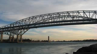 Bridge Timelapse Afternoon. The Blue Water Bridge connecting Port Huron, Michigan, USA with Sarnia, Ontario, Canada. The twin span bridge crosses the St. Clair river and connects Canada with the United States.