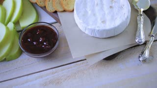 Brie cheese and cracker appetizer for  party table.