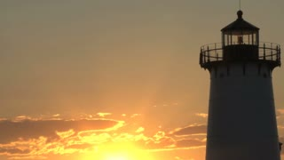 Bright Orange Sunset Behind Lighthouse