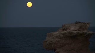 Bright Yellow Moon, Rock and Ocean