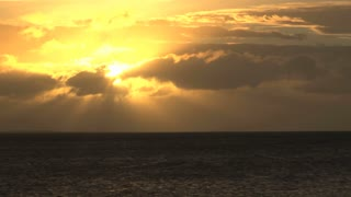 Bright Yellow Sun in Sky Over Ocean