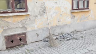 Broom Leaning On Wall