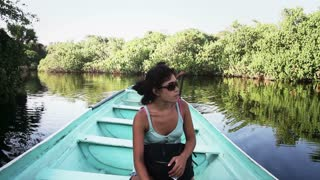 Brunette woman on boat river for ecological sightseeing