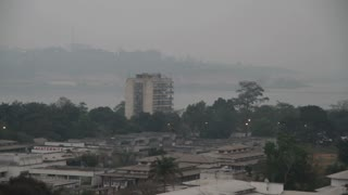 Buildings And Congo River With Smoke In Kinshasa