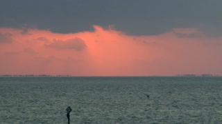 Burning Red Sun Sets Over Ocean Timelapse