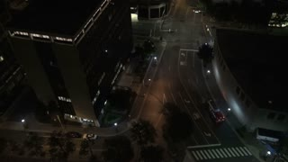 Bus Driving Empty Nighttime Street Aerial