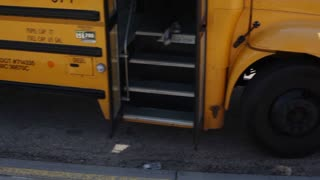Bus Drops off Students at School