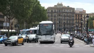 Bus Turning Down Busy Road in Spain