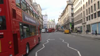 Buses Heading Through Piccadilly Circus