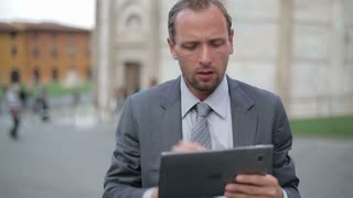 Business man in tourist city using tablet computer