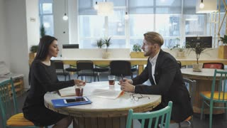 Business Partners at the meeting. Lady discusses strategy with a man. UHD video