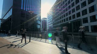 business people moving. real estate. business district. sunbeam silhouette