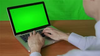 Business people working on a laptop With a green screen and approve the draft (work)show thumb up for approval .With a green screen background.chroma key.