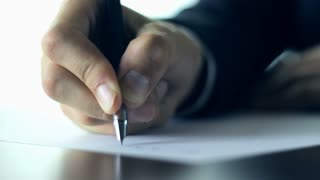 Business person writing a letter