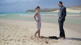 Businesscouple standing on the beach and talking