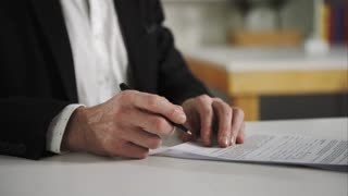Businessman signs documents