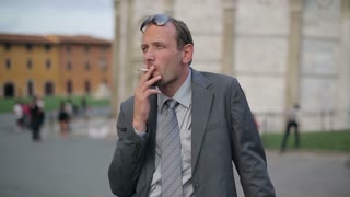 Businessman smoking cigarette