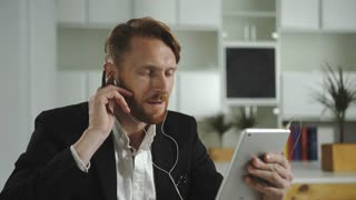 Businessman talking to a tablet. UHD 4Kvideo