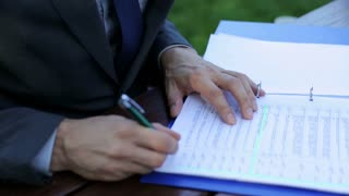 businessman's hands signing up documents