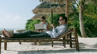 Businesspeople chatting on tablet in exotic place