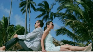 Businesspeople relaxing in exotic place