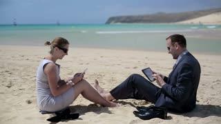 Businesspeople work on beach