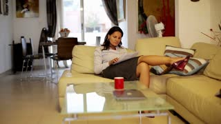Businesswoman relaxing after work in her apartment