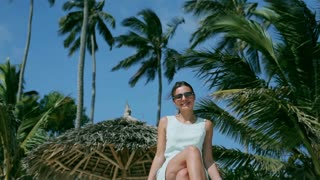 Businesswoman smiling to the camera in exotic place