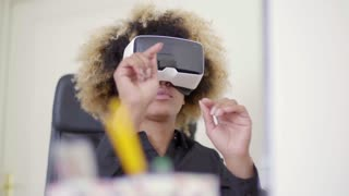 Businesswoman Working In Virtual Reality In Office