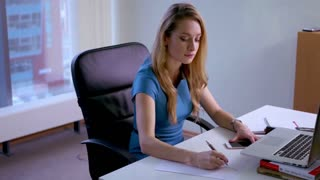 Businesswoman working on desktop computer