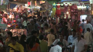 Bustling Marketplace at Night in India