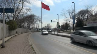 Bustling Traffic by Large Turkish Flag