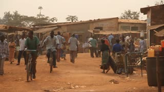 Busy African Street With Bicyclists And Pedestrians