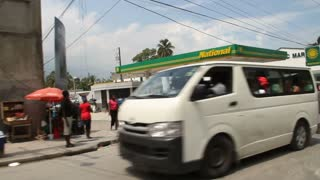 Busy Gas Station And Street Scene In Port-au-prince Haiti