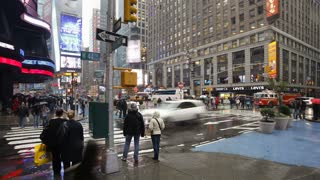 Busy intersection on a rainy evening on 42nd street at a busy street crossing, Times Square, Manhattan, New York City, New York, United States of America, North America, Time-lapse