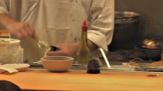Busy Restaurant Kitchen Cook Places Plate on Counter