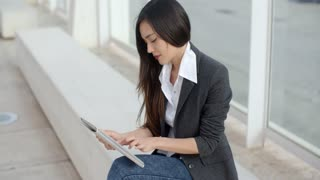 Calm professional woman using tablet