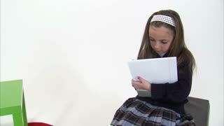 Camera Move Up and Above Eight Year Old Girl Doing Homework