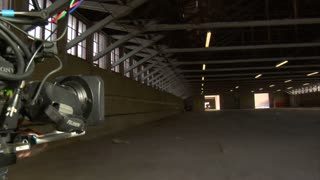 Camera Shooting Car Chase Through Warehouse