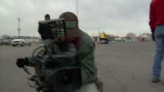 Cameraman Adjusting Large Film Camera