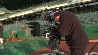 Cameraman And Crew Film In Empty Stadium