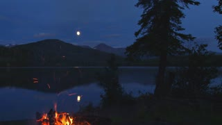 Campfire By Mountainside Lake