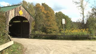 Car Drives Into Covered Bridge